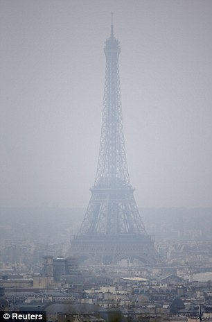 Hazy: Much of Paris still had heavy pollution levels on Monday despite attempts to cut down traffic fumes