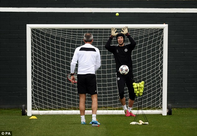 Looking up: Petr Cech was asked to catch tennis balls while still wearing his goalkeeping gloves in training