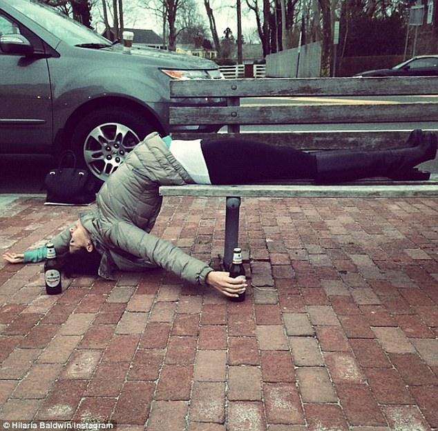 'Happy St. Patrick's Day!' Hilaria Baldwin dedicated Monday's yoga pose to the Irish cultural holiday as she folded herself backwards over a park bench surrounded by Guinness bottles in NYC