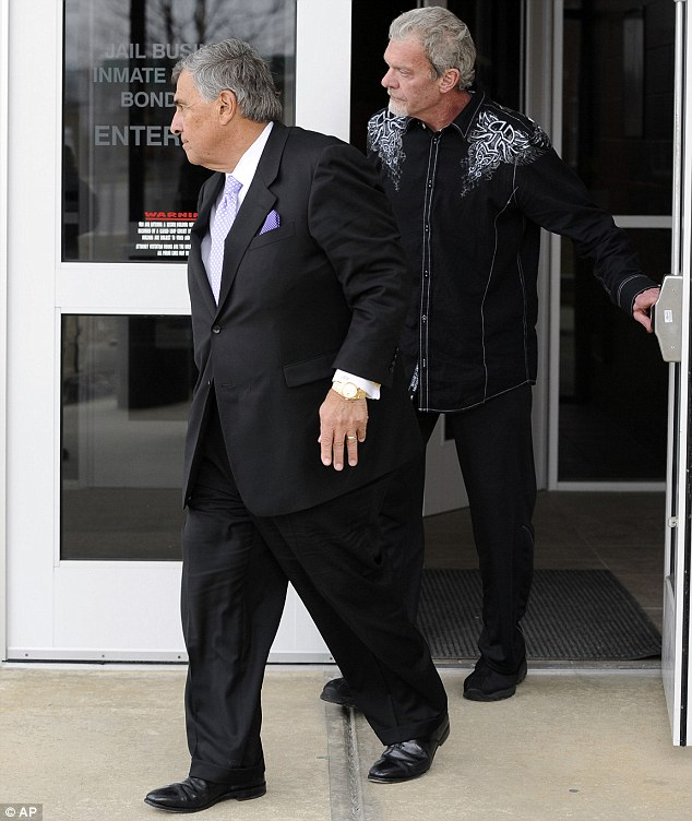 Jailed: Indianapolis Colts owner Jim Irsay, right, was jailed overnight after his DUI arrest last month