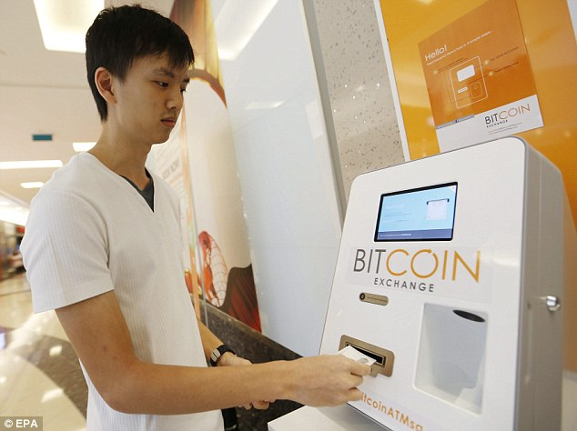 The creator of bitcoin - which has just installed its first ATM in Singapore (pictured) - was named as 'Satoshi Nakamoto', who created a complex form of electronic cash several years. Nakamoto says he is not that man
