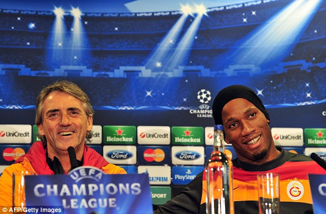Remember us? Drogba and former Manchester City boss Roberto Mancini
