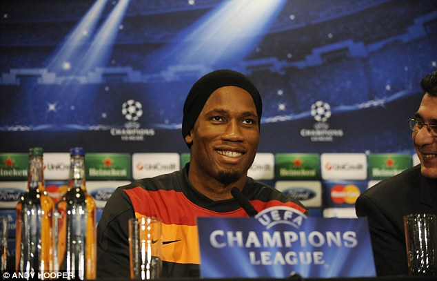 He's back: Drogba speaking to the media before training at Stamford Bridge on Monday