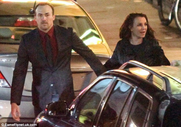 But wait! Brit appeared to be tied up in a conversation behind her as her boyfriend pushed on