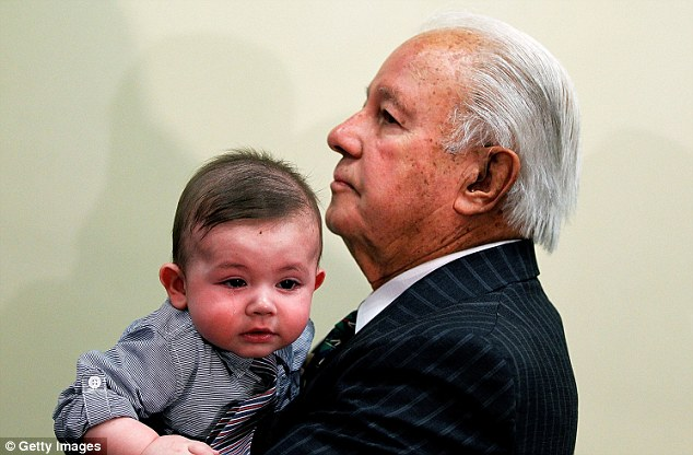 Father and son: Former Louisiana Gov. Edwin Edwards, 86, walks with Eli Edwards before announcing his run for U.S. Congress