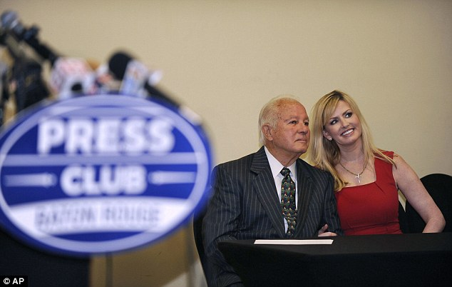 Husband and wife: Edwin Edwards, (left), poses with wife Trina Scott Edwards, (right), for photo, before speaking at the Baton Rouge Press Club, Monday, March 17, 2014, in Baton Rouge