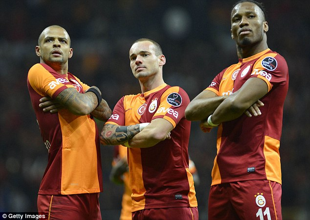 Three to fear: Drogba (right), Sneijder and Felipe Melo pose for the cameras earlier this season