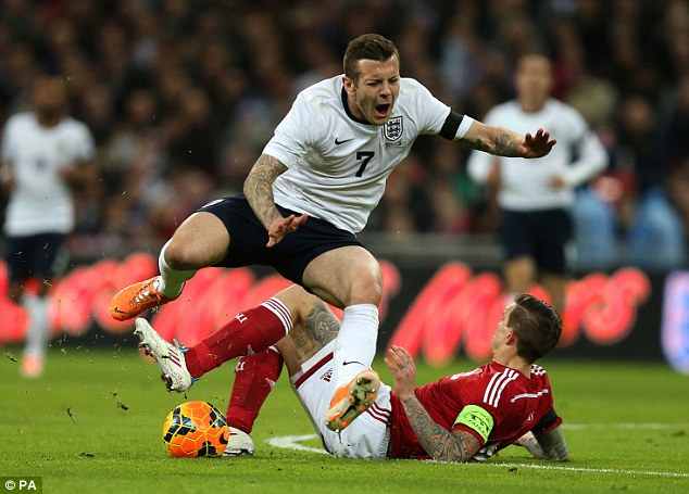 Crunch: Wilshere was injured after a strong tackle from Liverpool defender Daniel Agger