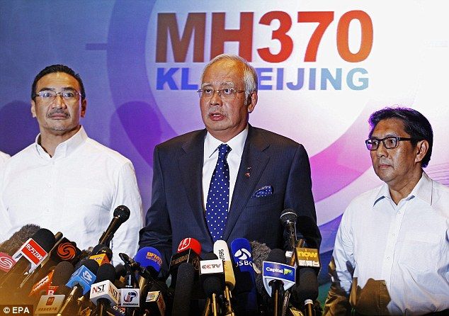 Malaysian Prime Minister Najib Abdul Razak (centre) accompanied by acting Transport Minister Hishammuddin Hussein (left) and Department Civil Aviation Director General Azharuddin Abdul Rahman (right), address a press conference at the Kuala Lumpur International Airport. Several theories are being investigated, including that there was a bomb on board