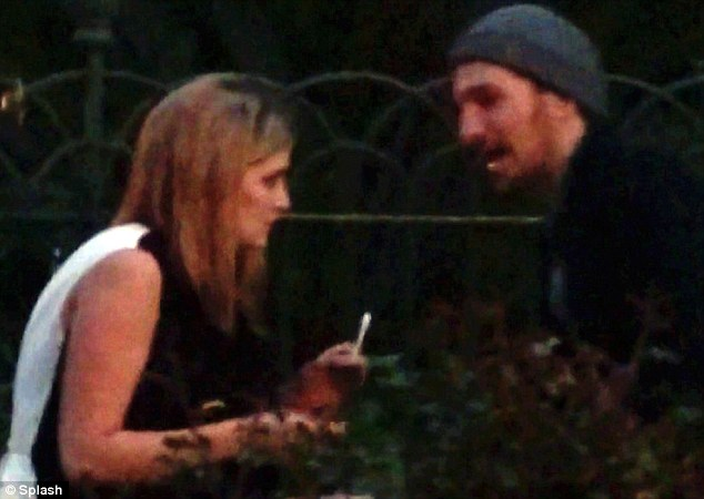 When in Rome: The pair then look set to have a cheeky cigarette amongst the bushes