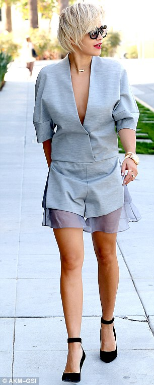Leggy lady: Rita's outfit drew attention to her cleavage as well as her tanned and toned legs