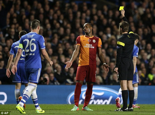 Going in the book: Drgoba shrugs as Felix Brych books him for a foul on Cesar Azpilicueta