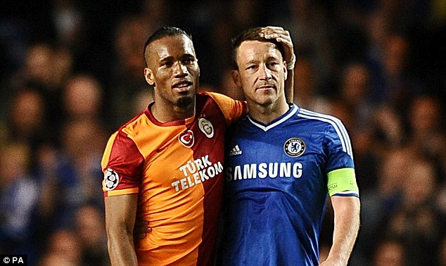 Like brothers in arms: Drogba and John Terry - who shared three Premier League title victories and a famous European Cup win - have a moment at Stamford Bridge