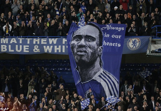 Folk hero: Chelsea fans unfurl a banner in honour of one of the greatest players in the club's history