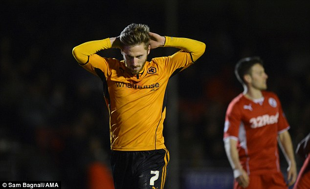 Tough night: James Henry of Wolves looks dejected after the 2-1 defeat to Crawley