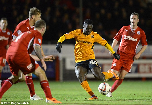 No way back: Nouha Dicko of Wolves Wanderers is outnumbered as he has a shot at goal
