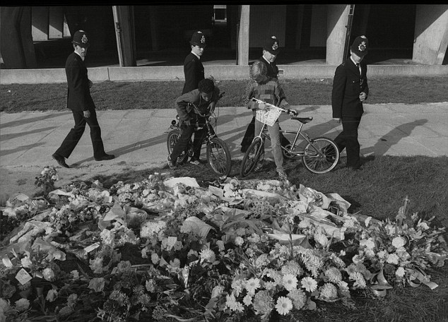 Tributes: Flowers left at the scene where PC Blakelock was killed during riots at the Broadwater Farm estate