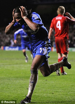 Celebration: The Chelsea forward wheels away after his decisive strike