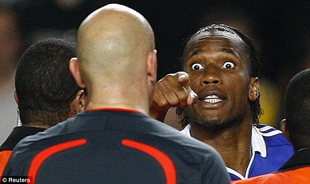 Wide-eyed: Drogba confronts referee Tom Henning Ovrebo before launching into his rant to camera