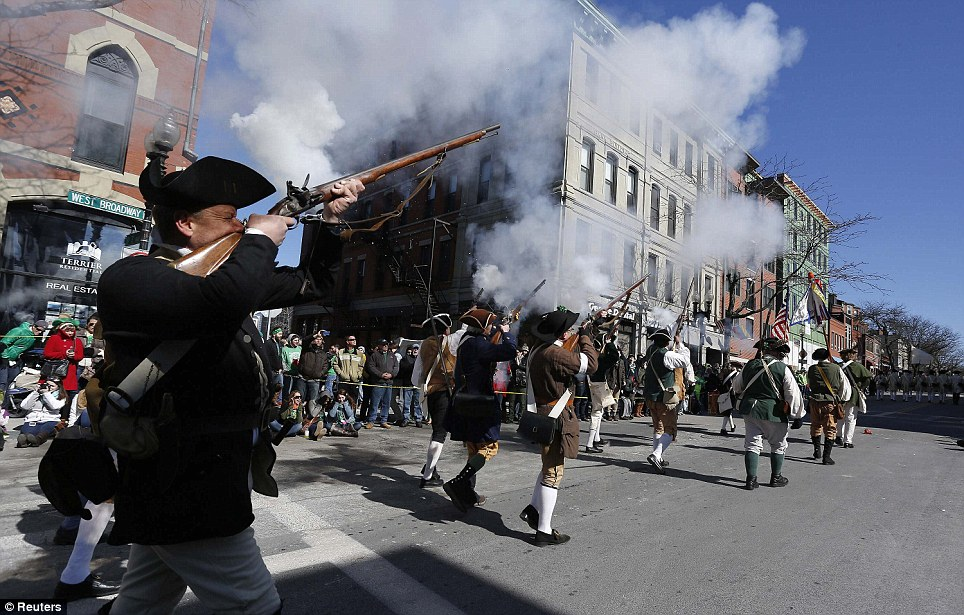 Explosive stuff: History comes alive with costumed re-enactments during the St Patrick's Day parade in Boston, Massachusetts