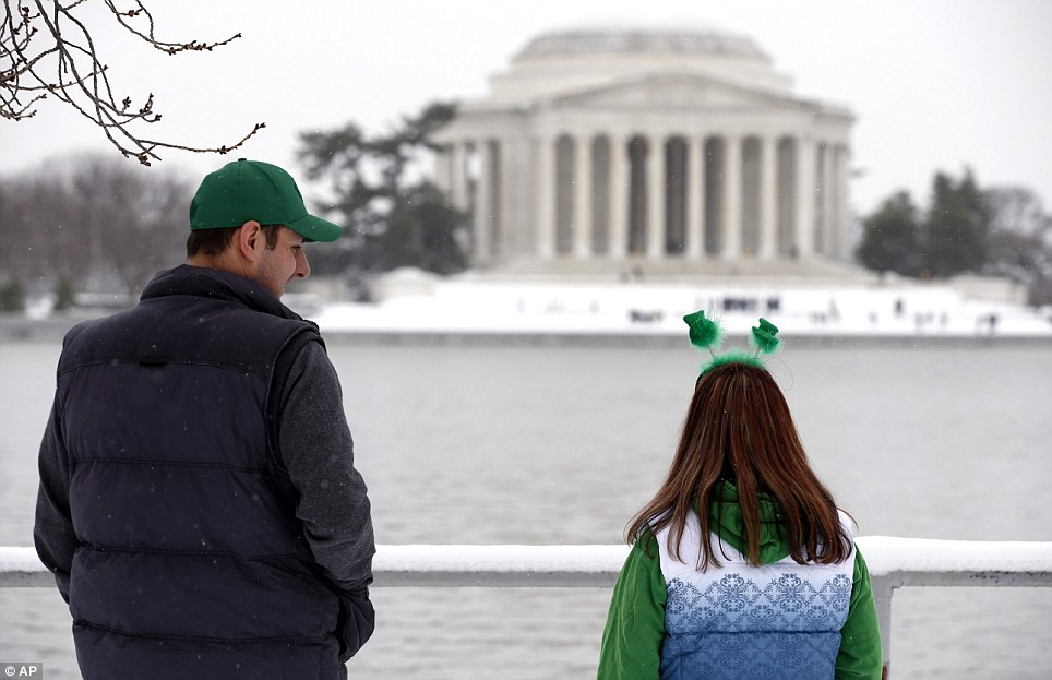 A more subtle celebration: Two Canadian tourists offer their own discreet tribute as they gaze at the Jefferson Memorial in Washington DC