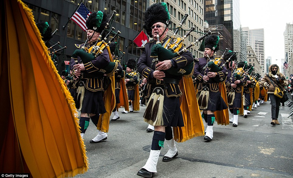 And the band played on: Pipers bring a hint of the old world to New York as the city's parade passes down Fifth Avenue