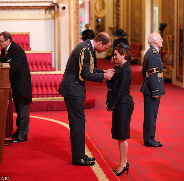 Commander of the British Empire: Ms Brady smiles as she receives her award