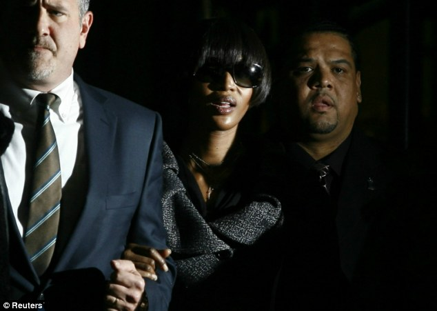 No model behaviour: Supermodel Naomi Campbell is escorted from Manhattan Criminal Court in 2007 after pleading guilty to assaulting her housekeeper with a mobile phone