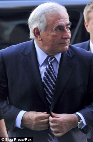 Dominique Strauss-Kahn enters the Manhattan Criminal Court with his wife Anne Sinclair