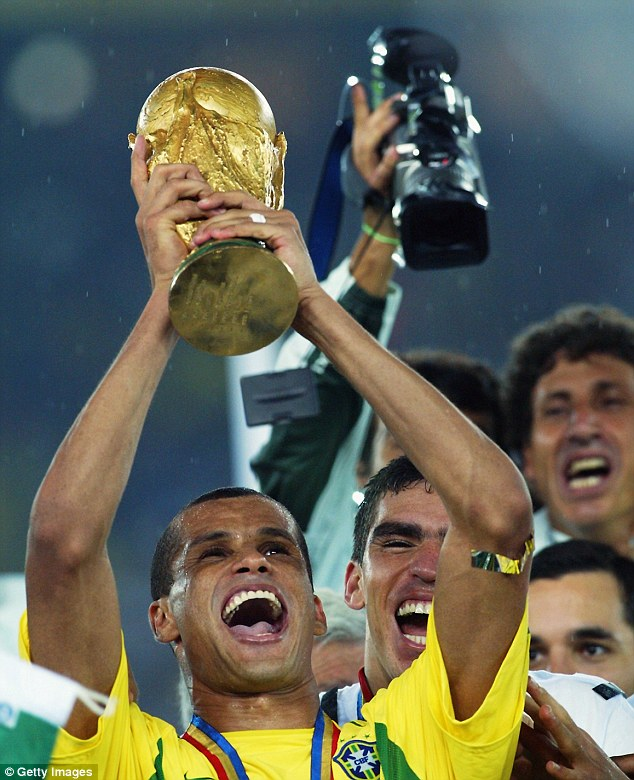 Serial winner: Rivaldo lifts the World Cup in 2002, Brazil's fifth triumph in the competition