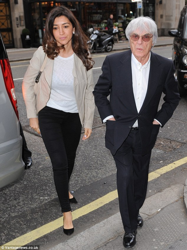Proud: Grandfather Bernie Ecclestone arrived at the hospital with Fabiana Flosi to meet the newborn