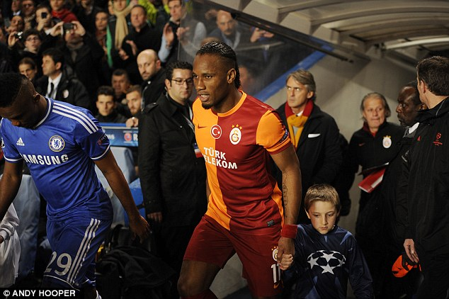 Return: Former Chelsea striker Didier Drogba emerges from the tunnel for Galatasaray