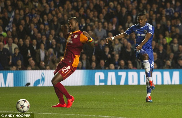 Unleashed: Eto'o shot low and hard across goal to give Chelsea the perfect start