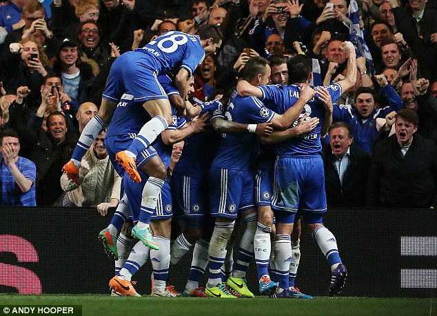 Jumping for joy: Chelsea players celebrate Cahill's goal on the stroke of half-time
