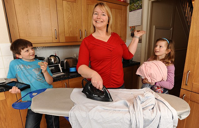 Pressing tasks: Jenny and her children Jake, 11, and Eloise, nine, on 'Free Leccy Saturday'
