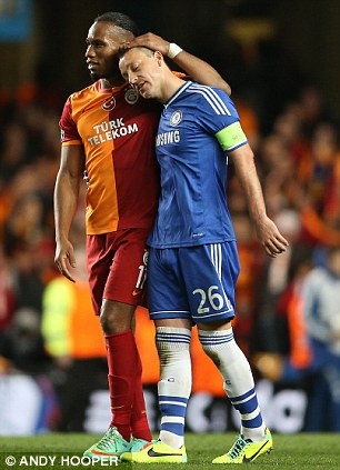 Love-in: Drogba and old friend John Terry embrace