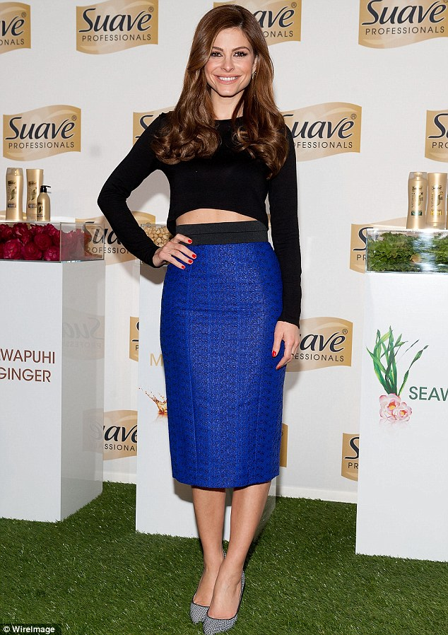 Hot to trot: Maria bared her midriff in her black and blue ensemble which included a crop top