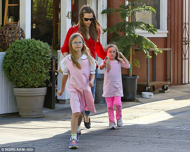 In the pink: The adorable sisters matched each other in a sweet shade of pale pink