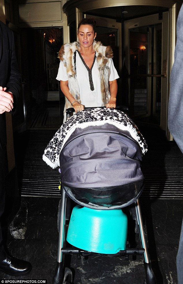 Quality time: Katie Price wheeled her baby son Jett out of London's Dorchester hotel on Tuesday