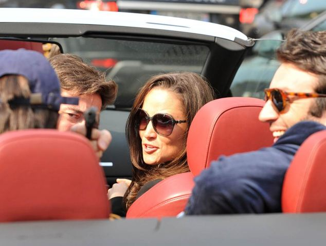 Pippa Middleton seen in a car with the Vicomte Arthur de Soultrait and other un-named people as one aims a gun jokingly at a photographer who was pursuing them to the Gard du Nord