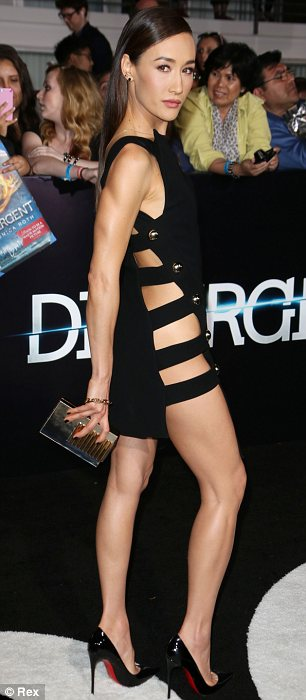 Flashing the flesh: Divergent's Maggie Q and singer Pia Mia Perez, who has contributed to the soundtrack, both showed off their trim figures in attention grabbing outfits