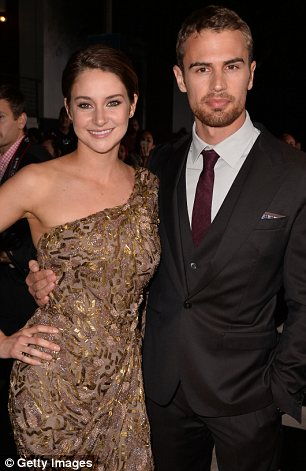 Close cast: Shailene cuddled up to Theo, who plays her love interest and Zoe Kravitz, who portrays her best friend in the flick