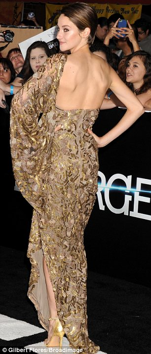 Centre of attention: Shailene Woodley grabbed attention in her dramatic slashed to the thigh gown at the Divergent premiere in LA on Tuesday