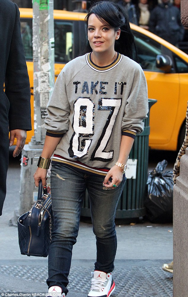 Say it out loud: Lily Allen went shopping in New York on Tuesday wearing a glitzy slogan T-shirt and jeans