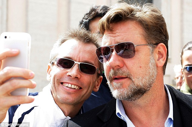 One for the album: Crowe poses for a selfie with a fan as he waited with crowds in St Peter's Square