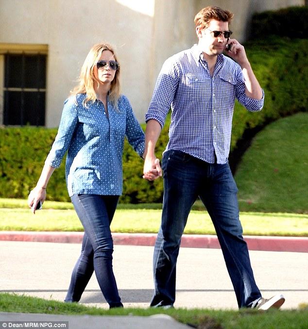Love is in the air: Emily and her husband John Krasinski walked hand-in-hand down the street