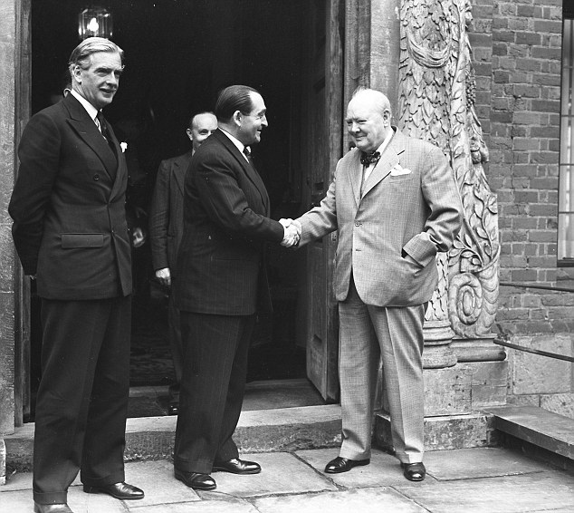 Sir Winston Curchill shakes hands with Pierre Mendes, watched by Anthony Eden, on the steps of Chartwell. After his resignation, He gave his full backing to his successor, Anthony Eden