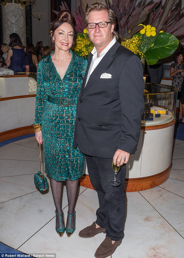 A vision in green: Designer Leona Edmiston, with her husband Jeremy Decker, wore a matching ensemble