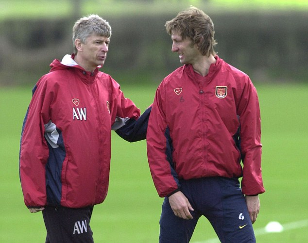 Master and pupil: Wenger and Tony Adams talk during an Arsenal training session in March 2001