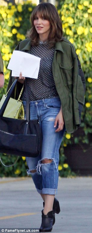 Stylish star: The actress had arrived on the set in a polka dot blouse, ripped boyfriend jeans and shoe boots, with a khaki jacket slung over her shoulders